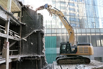 digger-at-urban-demolition-site-420x280