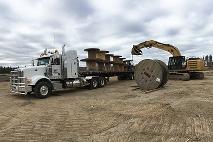 machinery-loading-flatbed-truck-420x280